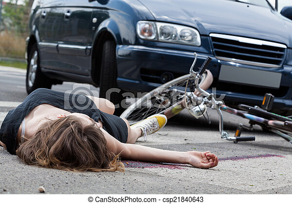 Unconscious cyclist after road accident - csp21840643
