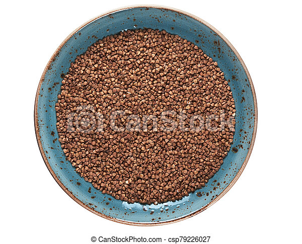 uncooked buckwheat in a plate isolated - csp79226027