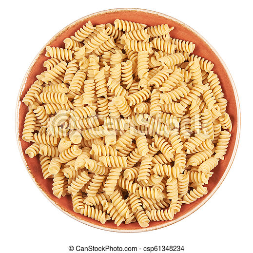 uncooked pasta on a plate - csp61348234
