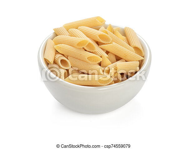 uncooked penne pasta isolated on a white background - csp74559079