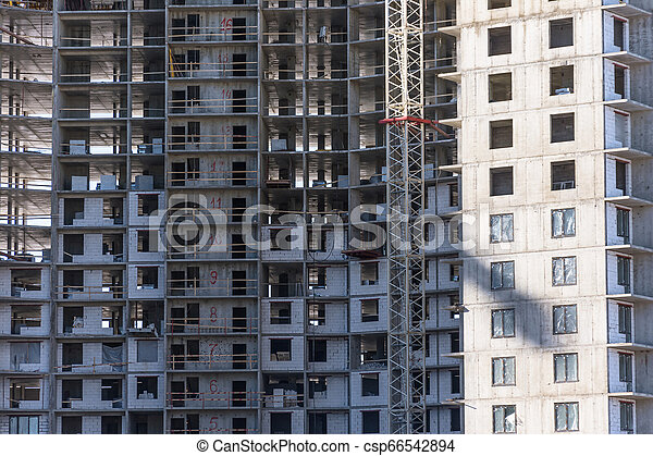 Under construction apartment building and residential real estate, close up view - csp66542894