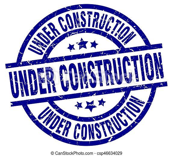 under construction blue round grunge stamp - csp46634029