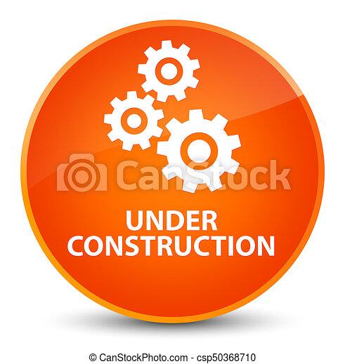 Under construction (gears icon) elegant orange round button - csp50368710