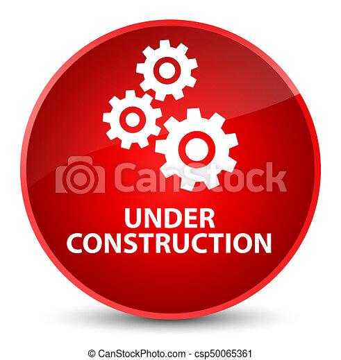 Under construction (gears icon) elegant red round button - csp50065361