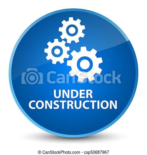 Under construction (gears icon) elegant blue round button - csp50687967