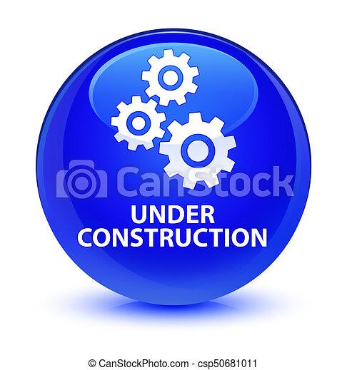 Under construction (gears icon) glassy blue round button - csp50681011