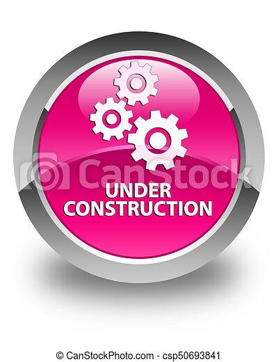 Under construction (gears icon) glossy pink round button - csp50693841