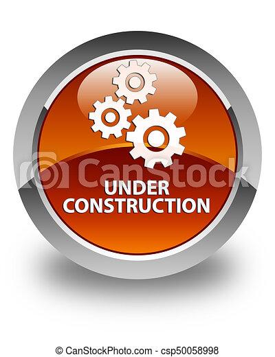 Under construction (gears icon) glossy brown round button - csp50058998