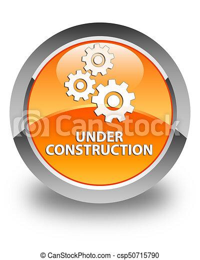 Under construction (gears icon) glossy orange round button - csp50715790