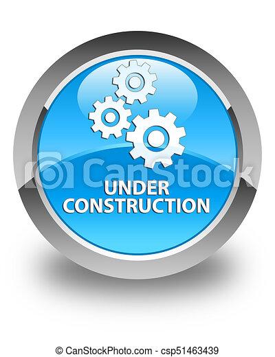 Under construction (gears icon) glossy cyan blue round button - csp51463439