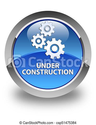 Under construction (gears icon) glossy blue round button - csp51475384