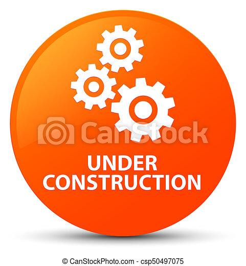 Under construction (gears icon) orange round button - csp50497075