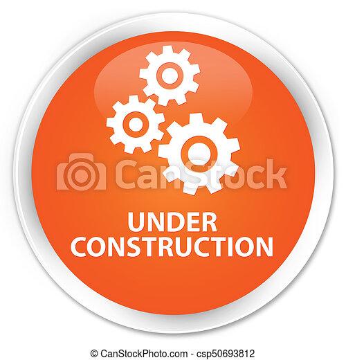 Under construction (gears icon) premium orange round button - csp50693812