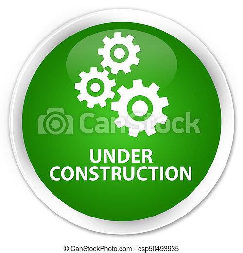 Under construction (gears icon) premium green round button - csp50493935