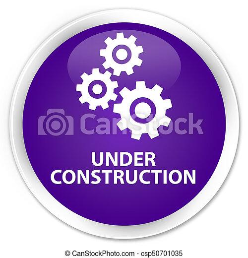 Under construction (gears icon) premium purple round button - csp50701035