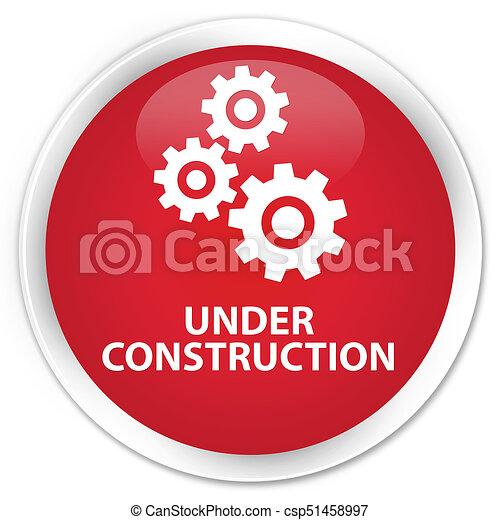 Under construction (gears icon) premium red round button - csp51458997