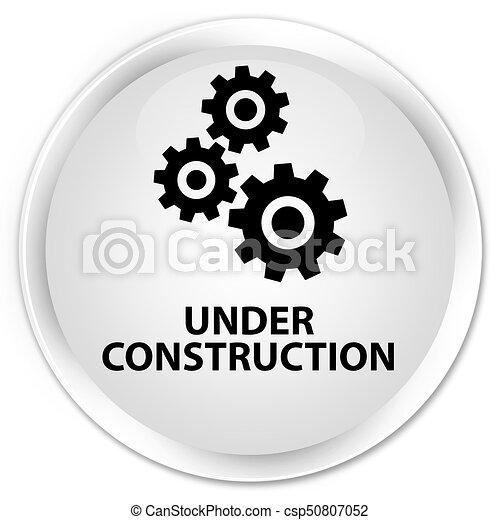 Under construction (gears icon) premium white round button - csp50807052