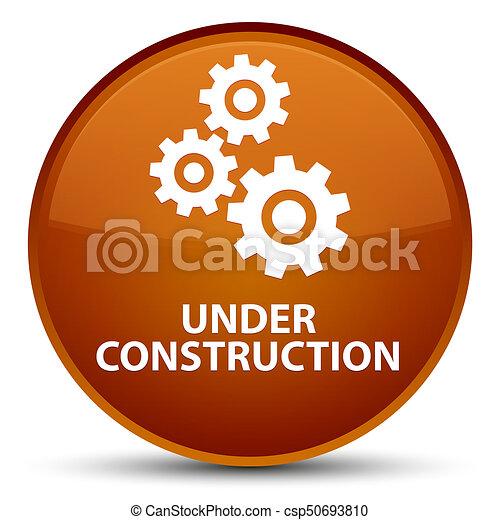 Under construction (gears icon) special brown round button - csp50693810