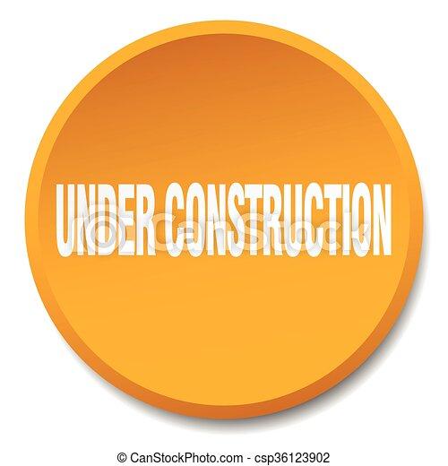 under construction orange round flat isolated push button - csp36123902