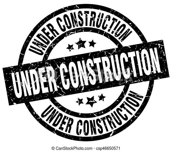 under construction round grunge black stamp - csp46650571
