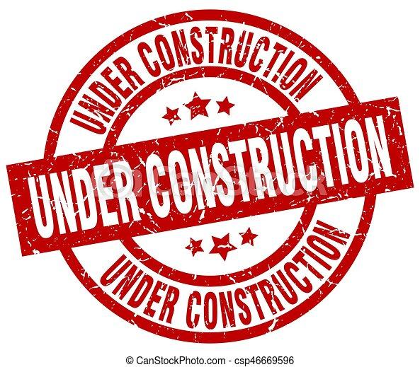 under construction round red grunge stamp - csp46669596