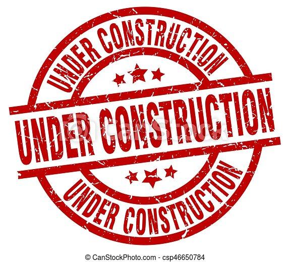 under construction round red grunge stamp - csp46650784