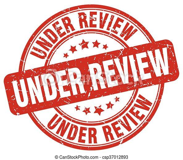 under review red grunge round vintage rubber stamp - csp37012893