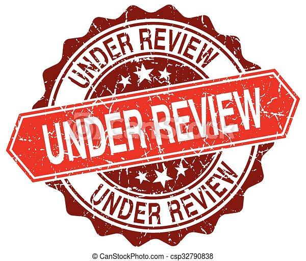 under review red round grunge stamp on white - csp32790838