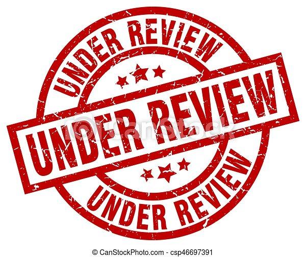 under review round red grunge stamp - csp46697391