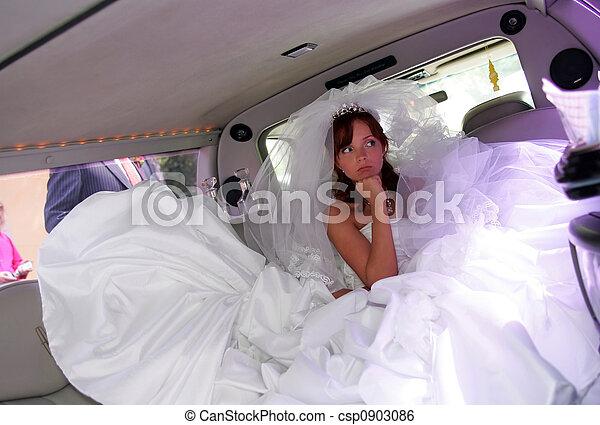 Unhappy bride in wedding car limousine - csp0903086