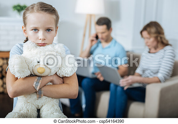 unhappy-child-and-her-parents-working-stock-photograph_csp54164390.jpg?profile=RESIZE_400x