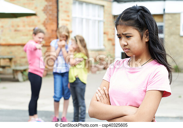 Unhappy Girl Being Gossiped About By School Friends - csp40325605
