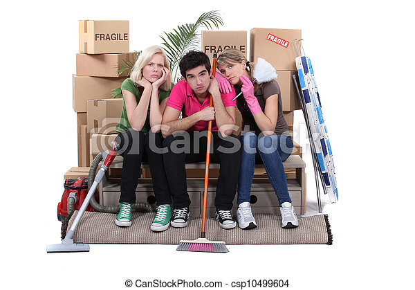 Unhappy housemates cleaning their flat before moving out - csp10499604