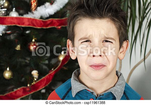 Unhappy little boy on christmass - csp11961388