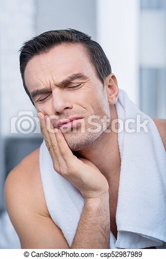 Unhappy tragic man feeling horrible - csp52987989