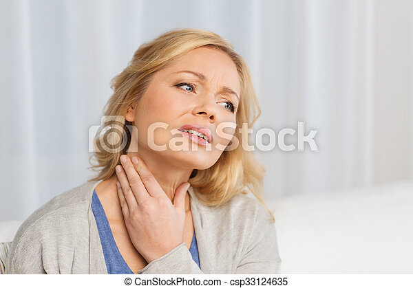 unhappy woman suffering from throat pain at home - csp33124635