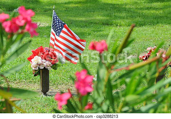 United States flag marking loss of military with flowers. - csp3288213