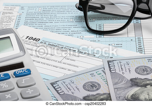 United States of America Tax Form 1040 with calculator, dollars and glasses - csp20402283