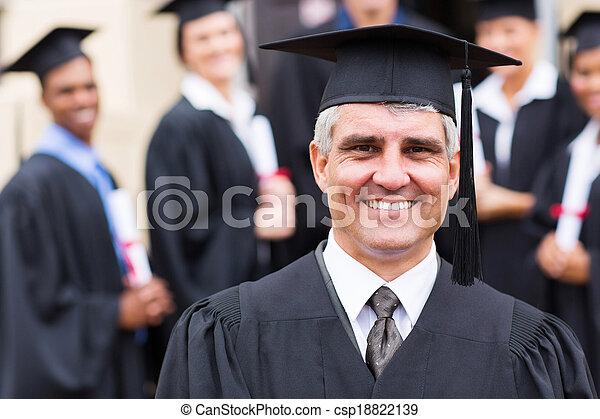 university professor in front of group of graduates - csp18822139