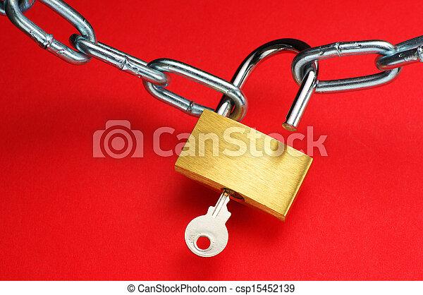 Unlocking padlock. - csp15452139