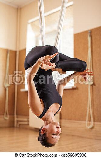 unnata aerial yoga including lotus pose full length side