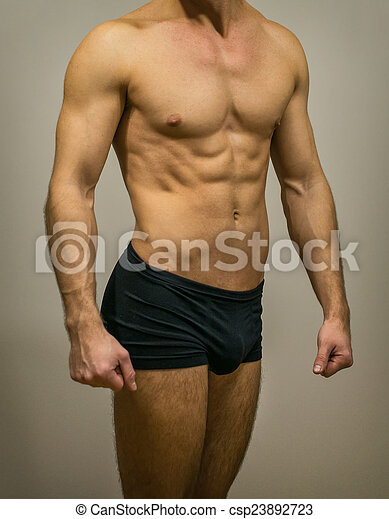 Unrecognizable Muscular Male Body On Grey Background Stock Photo