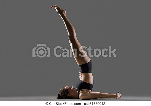 unsupported shoulder stand yoga pose portrait of
