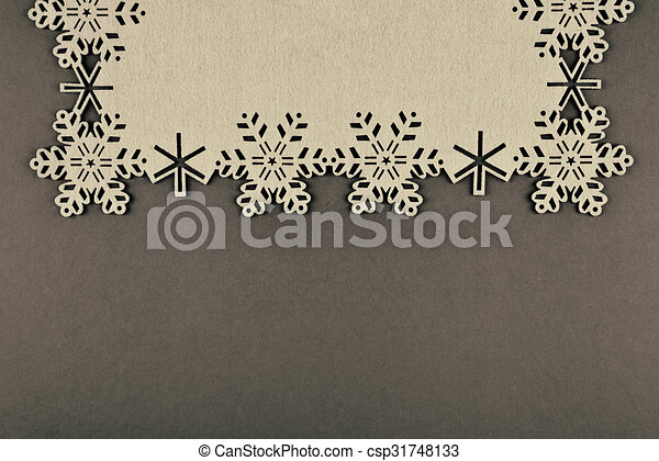 Unusual design christmas background with beige snowflakes and copy space on brown background - csp31748133