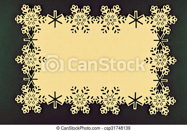 Unusual design christmas background with beige snowflakes and copy space on xmas green background - csp31748139