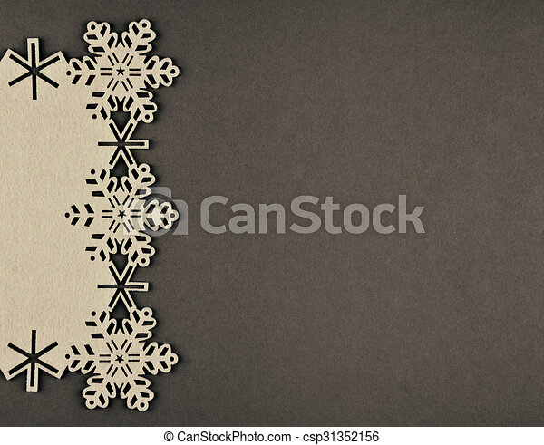 Unusual design christmas background with beige snowflakes and copy space on brown background - csp31352156