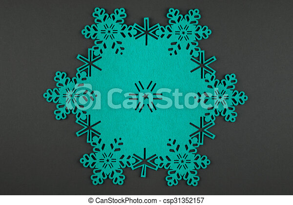Unusual design christmas background with turquoise snowflakes and copy space on dark grey background - csp31352157