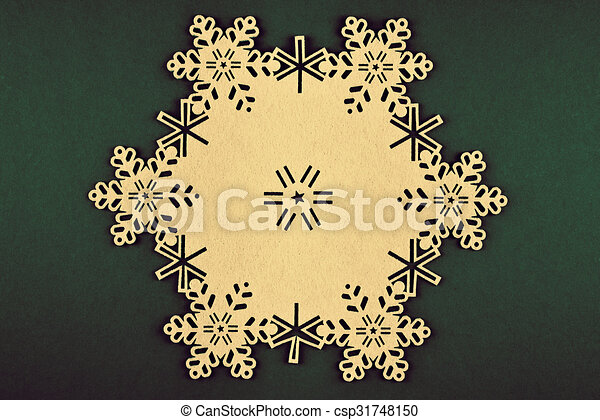 Unusual design christmas background with beige snowflakes and copy space on xmas green background - csp31748150