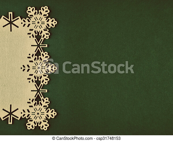 Unusual design christmas background with beige snowflakes and copy space on xmas green background - csp31748153