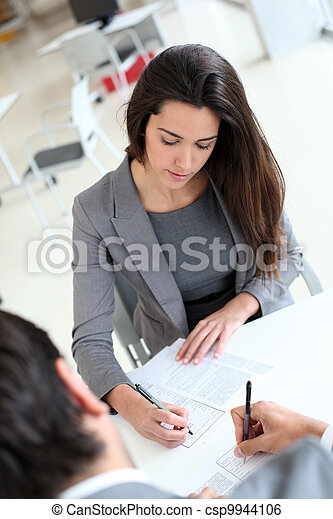 Upper view of business people signing contract - csp9944106